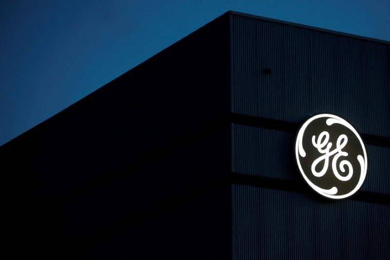 FILE PHOTO: The General Electric logo is pictured on the General Electric offshore wind turbine plant in Montoir-de-Bretagne, near Saint-Nazaire, western France, November 21, 2016. REUTERS/Stephane Mahe/File Photo