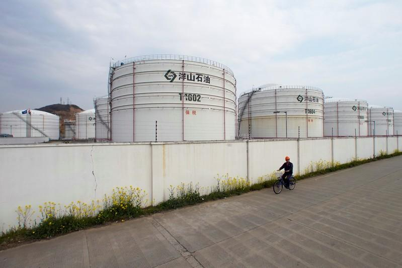 FILE PHOTO: Oil tanks are seen at an oil warehouse at Yangshan port in Shanghai, China March 14, 2018. REUTERS/Aly Song